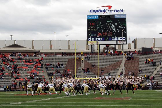 The Georgia Tech Yellow Jackets offense runs a play against the Maryland Terrapins defense during the second half at Byrd Stadium on November 3, 2012 in College Park, Maryland.