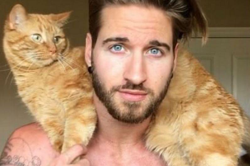Man Uses Cat as Kettlebell