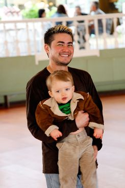 Thomas Beatie and his son Jensen enjoy a day at Grona Lund amusement park on August 7, 2011 in Stockholm, Sweden.