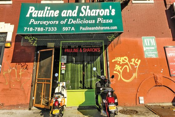 66.  <b>Pauline & Sharon's</b>  On a 91-degree day with no air-conditioning, you want to give the guy the benefit of the doubt. But the pizza man who runs the joint is a muttering grump. And calling the tiny space a miserable dump might be the nicest thing anyone has ever said about it. But you're not here to make new friends and chat about interior design; you're here for one of the most satisfying slices you've had in a while—remarkably flavorful and surprisingly crisp-crusted despite its supercolossal size and droopy posture. Wolf it down, then get the hell out.  <i>597A Fourth Ave., nr. 17th St., Park Slope; 718-788-7333</i>