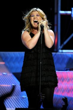 MELBOURNE, AUSTRALIA - APRIL 2010: Kelly Clarkson performs on stage at Rod Laver Arena on 19th April 2010 in Melbourne, Australia. (Photo by Martin Philbey/Redferns) *** Local Caption *** Kelly Clarkson performs at Rod Laver Arena