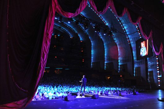 Dave Chappelle performs onstage at Radio City Music Hall on June 18, 2014 in New York City.  (Photo by Kevin Mazur/WireImage)