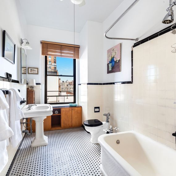 Large bathroom with a white tub.