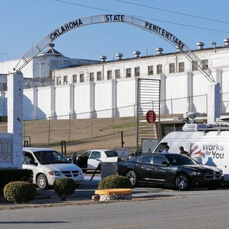 A news van arrives at the front gate of the Oklahoma State Penitentiary for the scheduled execution of Charles Warner in McAlester, Okla, Thursday, Jan. 15, 2015.