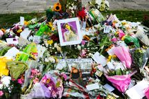Flowers, pictures and messages are left in tribute to late soul music and pop star Amy Winehouse, near the house in north London where her body was found the previous day, on July 24, 2011. Soon after the 27-year-old songstress's death was announced on July 23, fans started gathering in Camden Square, north London, to bid farewell to a star whose songs often reflected her tempestuous lifestyle. AFP PHOTO/CARL COURT (Photo credit should read CARL COURT/AFP/Getty Images)
