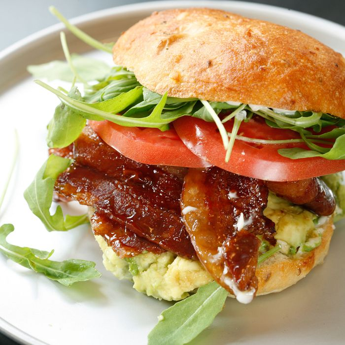 Sumner Roll: glazed bacon, avocado, beefsteak tomatoes, butter lettuce, mayonnaise, and house-made ssäm sauce on a potato bun.