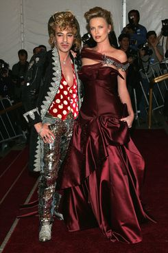 Designer John Galliano and actress Charlize Theron attend the Metropolitan Museum of Art Costume Institute Benefit Gala: Anglomania at the Metropolitan Museum of Art May 1, 2006 in New York City.