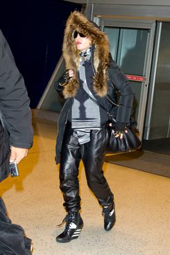 Madonna arrives to catch a flight with daughter Mercy James at JFK airport in New York City.