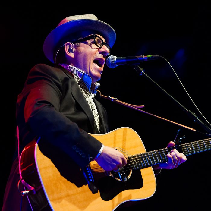 TILBURG, NETHERLANDS - JULY 19: Elvis Costello performs on stage at 013 on July 19, 2013 in Tilburg, Netherlands. (Photo by Dimitri Hakke/Redferns via Getty Images)