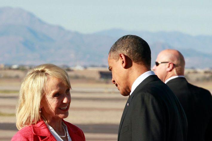 President Barack Obama talks with Arizona Gov. Jan Brewer after arriving at Phoenix-Mesa Gateway Airport, Wednesday, Jan. 25, 2012, in Mesa, Ariz.