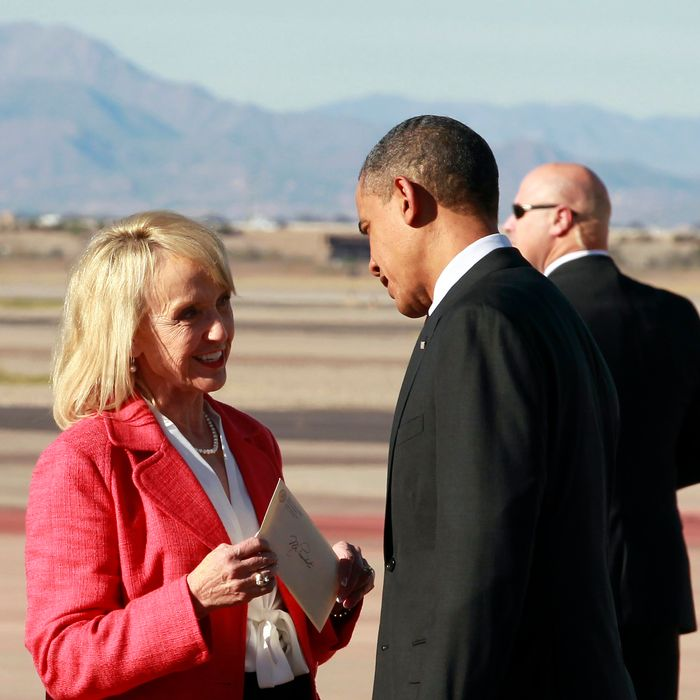 President Barack Obama talks with Arizona Gov. Jan Brewer after arriving at Phoenix-Mesa Gateway Airport, Wednesday, Jan. 25, 2012, in Mesa, Ariz.