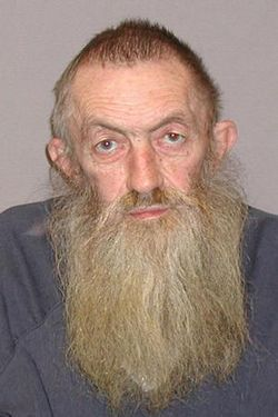 Popcorn Sutton's mug shot: How you want your moonshiner to look.