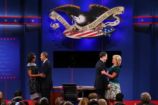 U.S. President Barack Obama (2L) and first lady Michelle Obama (L) stand on stage with Republican presidential candidate Mitt Romney and wife, Ann Romney after the debate at the Keith C. and Elaine Johnson Wold Performing Arts Center at Lynn University on October 22, 2012 in Boca Raton, Florida. The focus for the final presidential debate before Election Day on November 6 is foreign policy.