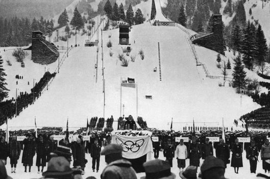 Athletes from 28 nations listen to the speech of Karl Ritter von Halt (C), president of the Garmisch-Partenkirchen Olympic organizing committee 06 February 1936 during the opening ceremony of the IVth Winter Olympic Games. (N&B)  (Photo credit should read CORR/AFP/Getty Images)