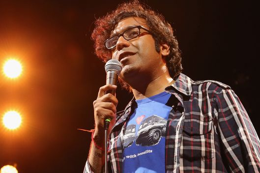 "NEW YORK, NY - JULY 11:  Comedian Hari Kondabolu  performs at Nelson George's multimedia presentation, ""Vote, It Ain't Illegal Yet!"" during 2014 Celebrate Brooklyn! at the Prospect Park Bandshell on July 11, 2014 in the Brooklyn borough of New York City.  (Photo by Al Pereira/WireImage)"
