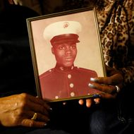 """FILE - In this March 12, 2014, file photo, a picture of Jerome Murdough is held by his mother and sister in the Queens borough of New York. Murdough, a 56-year-old mentally ill inmate at Rikers Island jail, """"baked"""" to death in his overheated cell during one of the coldest recorded winters in city history. According to documents obtained by The Associated Press, jail officials were aware of malfunctioning heating equipment and requested repairs the last day Murdough was seen alive, but the needed work didn't happen until it was too late because of a long holiday weekend.  (AP Photo/Jason DeCrow, File)"""