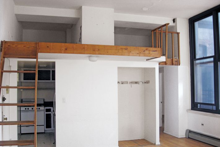 The loft in 2011: hidden kitchen, sad closet, rickety ladder.