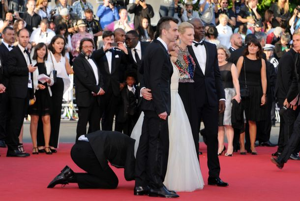 CANNES, FRANCE - MAY 16:   A man invades the Red Carpet as Jay Baruchel, Kit Harington, America Ferrera, Cate Blanchett and Djimon Hounsou pose at the 'How To Train Your Dragon 2' premiere during the 67th Annual Cannes Film Festival on May 16, 2014 in Cannes, France.(Photo by Traverso/L'Oreal/Getty Images)