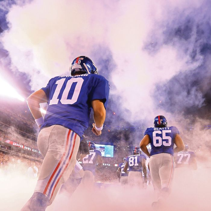 EAST RUTHERFORD, NJ - SEPTEMBER 05: Quarterback Eli Manning #10, tackle Will Beatty #65 and the rest of the New York Giants take the fileld prior to playing against the Dallas Cowboys during the 2012 NFL season opener at MetLife Stadium on September 5, 2012 in East Rutherford, New Jersey. (Photo by Al Bello/Getty Images)