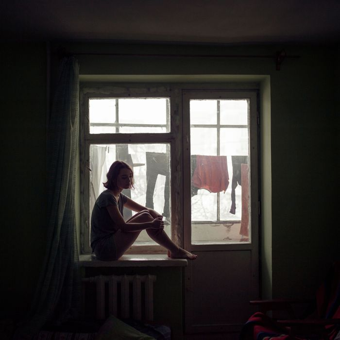Woman in window.