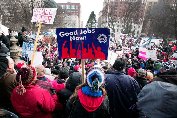 Union members from around the country rally at the Michigan State Capitol to protest a vote on Right-to-Work legislation December 11, 2012 in Lansing, Michigan. Republicans control the Michigan House of Representatives, and Michigan Gov. Rick Snyder has said he will sign the bill if it is passed. The new law would make requiring financial support of a union as a condition of employment illegal.