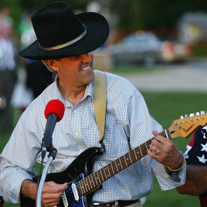 JEFFERSON CITY, MO - AUGUST 5: Democratic presidential nominee US Sen. John Kerry (D-MA) plays guitar during a rally August 5, 2004 in Jefferson City, Missouri. Kerry continues on the two-week, 3,500 mile