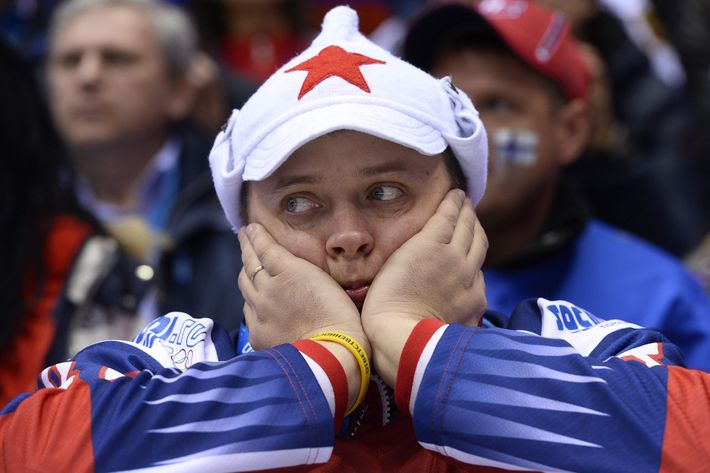 A Russian supporter reacts during the Men's Ice Hockey Play-offs Quarterfinals match between Finland and Russia at the Bolshoy Ice Dome during the Sochi Winter Olympics on February 19, 2014. Finland won 3-1.     AFP PHOTO / JONATHAN NACKSTRAND        (Photo credit should read JONATHAN NACKSTRAND/AFP/Getty Images)