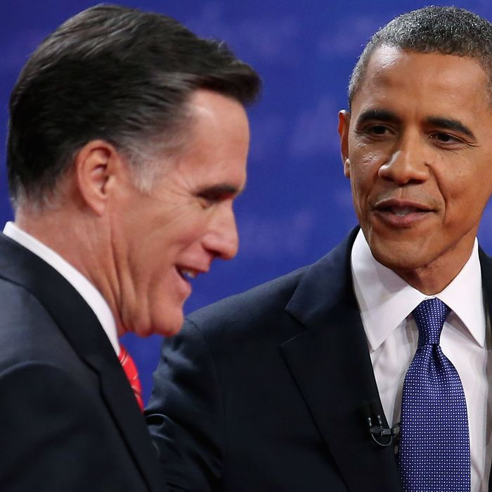 DENVER, CO - OCTOBER 03: Democratic presidential candidate, U.S. President Barack Obama (R) and Republican presidential candidate, former Massachusetts Gov. Mitt Romney speak after the Presidential Debate at the University of Denver on October 3, 2012 in Denver, Colorado. The first of four debates for the 2012 Election, three Presidential and one Vice Presidential, is moderated by PBS's Jim Lehrer and focuses on domestic issues: the economy, health care, and the role of government. (Photo by Chip Somodevilla/Getty Images)