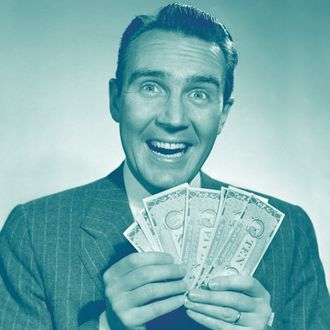 1950s happy man with exaggerated smile holding fan of money looking at camera