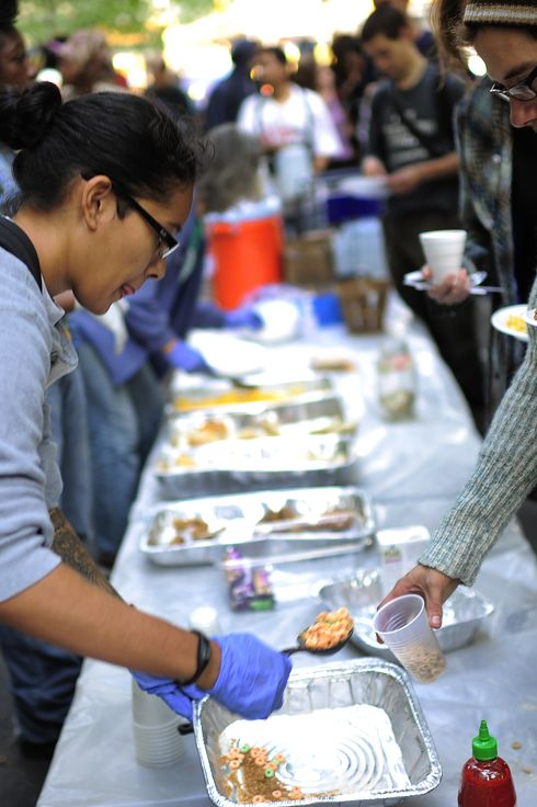 "Members of Occupy Wall Street line up for their free breakfast served by volunteers after spending the night on Zuccotti Park near Wall Street in New York, October 11, 2011. Protesters from the Occupy Wall Street movement scheduled a ""Millionaires March"" taking their march in front of the homes of some of New York City's wealthiest residents in Manhattan Upper East Side. AFP PHOTO/Emmanuel Dunand (Photo credit should read EMMANUEL DUNAND/AFP/Getty Images)"