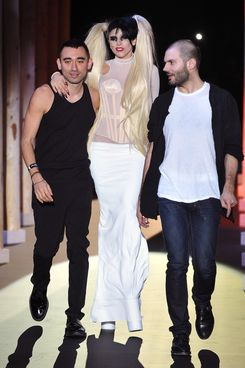 PARIS, FRANCE - MARCH 02:  Nicola Formichetti, Lady Gaga and Sebastian Peigne walk the runway during the Thierry Mugler Ready to Wear Autumn/Winter 2011/2012 show during Paris Fashion Week at Gymnase Japy on March 2, 2011 in Paris, France.  (Photo by Francois Durand/Getty Images)