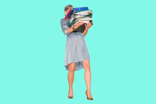 Businesswoman holding stack of binders