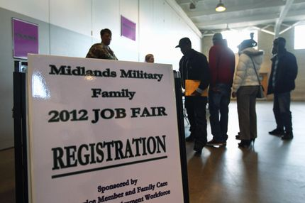 South Carolina National Guardsmen, veterans and their families line up to meet potential employers at a military job fair on January 19, 2012 in Columbia, South Carolina.