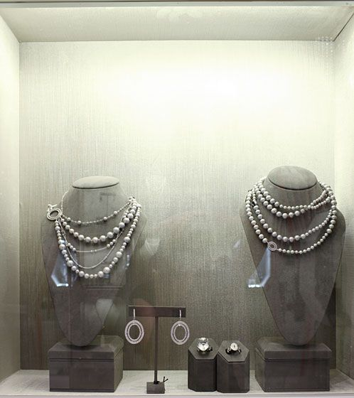 Multi-strand pearl, diamond, and stone white-gold necklace with large oval diamond clasp, $12,000; large oval diamond earrings, $38,000; oval rock crystal ring with diamond band, $3,650; small pave diamond oval pand ring, $2,400.