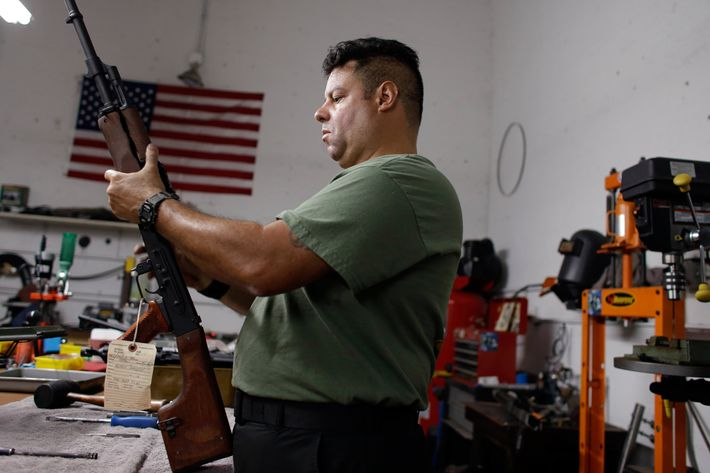 Milton Gonzalez, 46, an employee of Nebulous Ordnance, adjusts the springs of the safety on a RPK rifle, Tuesday, April 9, 2013, in Miami, Florida.