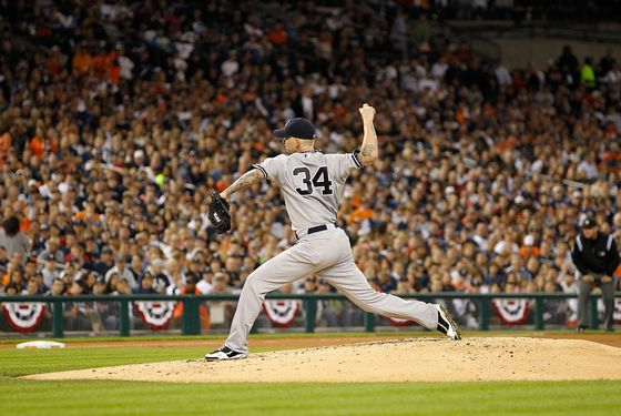 DETROIT, MI - OCTOBER 04:  A J Burnett #34 of the New York Yankees pitches in the third inning during Game Four of the American League Divison Series against the Detroit Tigers at Comerica Park on October 4, 2011 in Detroit, Michigan. The Yankees defeated the Tigers 10-1.  (Photo by Leon Halip/Getty Images)