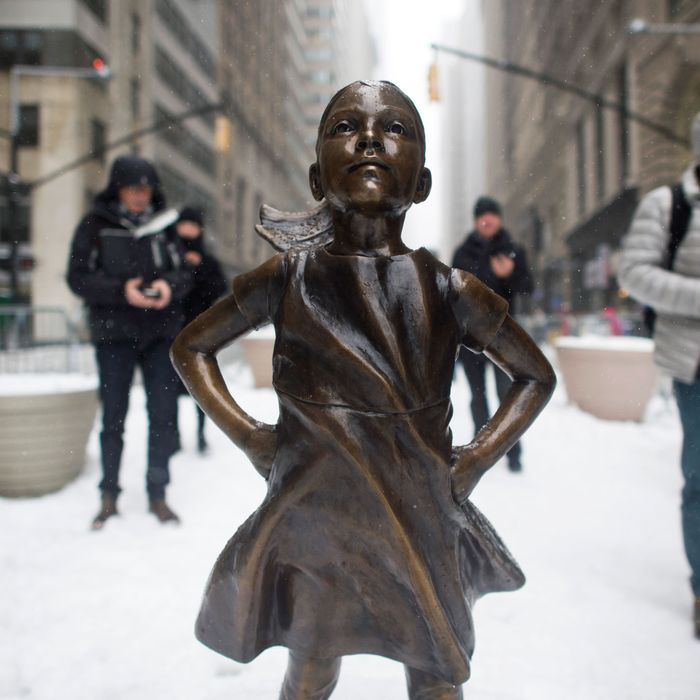 Wall Street s  Fearless Girl  Statue Vandalized to Look Like Trump Supporter 532ef5b09bcfc