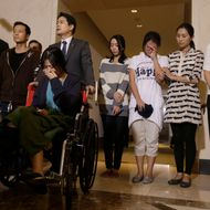 Flight crew members from Asiana Flight 214, which crashed on Saturday, July 6, 2013, appear at a news conference at San Francisco International Airport in San Francisco, Wednesday, July 10, 2013. (AP Photo/Jeff Chiu)