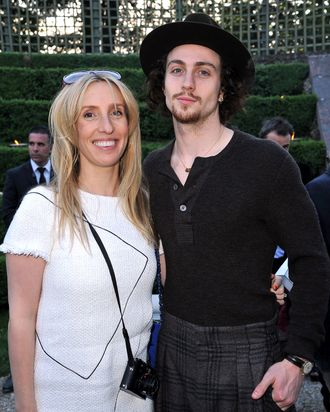 Sam Taylor-Wood and Aaron Johnson pose during the Chanel 2012/13 Cruise Collection at Chateau de Versailles on May 14, 2012 in Versailles, France.