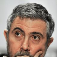 """Professor of Economics and International Affairs at Princeton University, New York Times columnist, and 2008 Nobel Peace Prize winner in Economics, Paul Krugman, listens to his introduction before delivering remarks February 11, 2009 at the Institute for America's Future """"Thinking Big, Thinking Forward""""  conference on America's economic future at the Capitol Hilton in Washington, DC.   AFP Photo/Paul J. Richards (Photo credit should read PAUL J. RICHARDS/AFP/Getty Images)"""