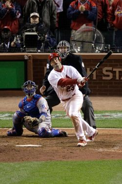 ST LOUIS, MO - OCTOBER 27:  David Freese #23 of the St. Louis Cardinals hits a walk off solo home run in the 11th inning to win Game Six of the MLB World Series against the Texas Rangers at Busch Stadium on October 27, 2011 in St Louis, Missouri. The Cardinals won 10-9.  (Photo by Rob Carr/Getty Images)