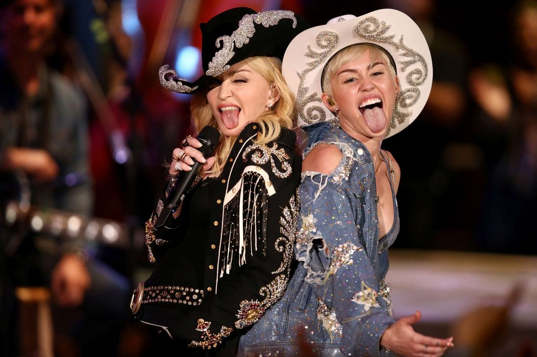 Madonna and Miley Cyrus perform onstage during Miley Cyrus: MTV Unplugged at Sunset Gower Studios on January 28, 2014 in Hollywood, California. Miley Cyrus: MTV Unplugged premieres on January 29, 2014 on MTV at 9/8 PM.