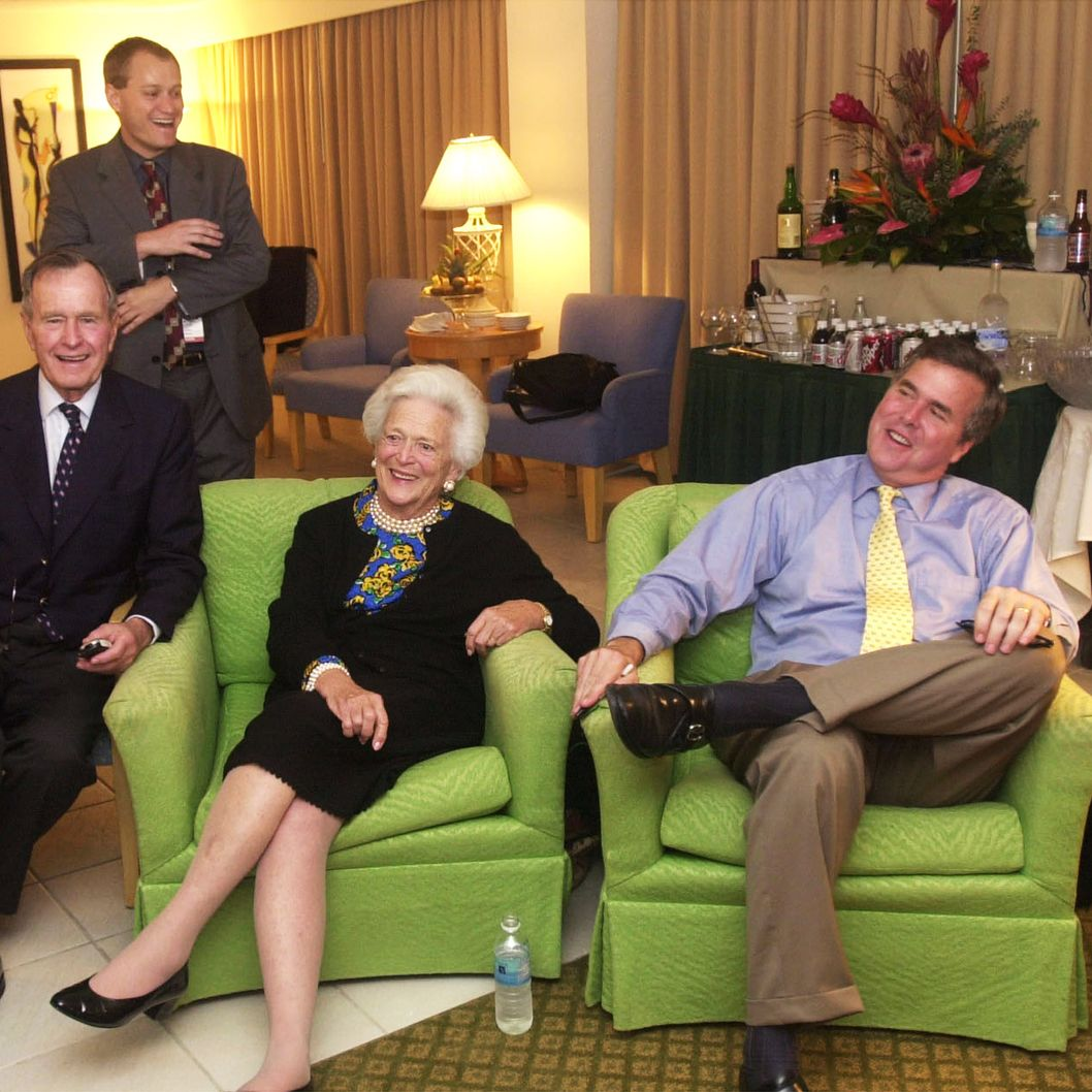 Republican Florida Governor Jeb Bush (R) and his parents, former President George and Barbara Bush, await election returns November 5, 2002 in their Miami, Florida hotel room.  Bush is facing Democratic challenger Bill McBride, a Tampa lawyer. Victory for Bush would make him the first Republican governor re-elected in state history. In the background is Bush campaign communications director Todd Harris. (Photo by Joe Burbank/Pool/Getty Images)