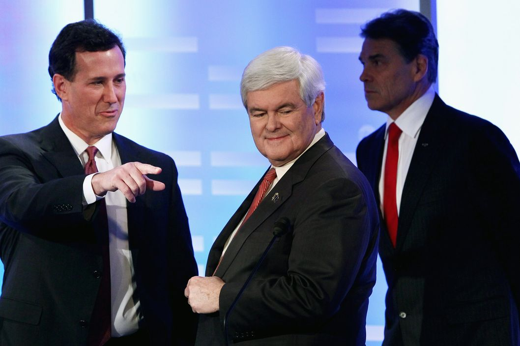 Former U.S. Sen. Rick Santorum, and former Speaker of the House Newt Gingrich during a commercial break in the  Republican Presidential Debate at Saint Anselm College January 7, 2012 in Manchester, New Hampshire.