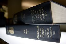 An Oxford English Dictionary is shown at the headquarters of the Associated Press in New York on Sunday, Aug. 29, 2010. It's been in print for over a century, but in future the Oxford English Dictionary _ the authoritative guide to the English language _ may only be available online. Oxford University Press, the publisher, said Sunday that burgeoning demand for the dictionary's online version has far outpaced demand for the printed versions. (AP Photo/Caleb Jones)