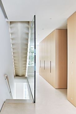 The staircase channels light through the house's five stories.