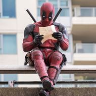 DEADPOOLRyan Reynolds as Deadpool relaxes before leaping into battle.Photo Credit: David DolsenTM & © 2015 Marvel & Subs. TM and © 2015 Twentieth Century Fox Film Corporation. All rights reserved. Not for sale or duplication.