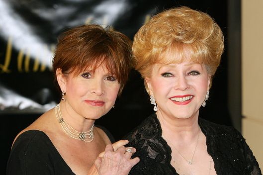Actress Carrie Fisher (L) and her mother, actress Debbie Reynolds, arrive for Dame Elizabeth Taylor's 75th birthday party at the Ritz-Carlton, Lake Las Vegas on February 27, 2007 in Henderson, Nevada.