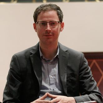 Nate Silver sits on the stairs at a hotel in Chicago on Friday, Nov. 9, 2012. The 34-year-old statistician, unabashed numbers geek, author and creator of the much-read FiveThirtyEight blog at The New York Times, correctly predicted the presidential winner in all 50 states, and almost all the Senate races.
