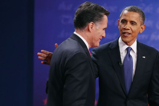 DENVER, CO - OCTOBER 03:  Democratic presidential candidate, U.S. President Barack Obama (R) pats Republican presidential candidate, former Massachusetts Gov. Mitt Romney on the back after the Presidential Debate at the University of Denver on October 3, 2012 in Denver, Colorado. The first of four debates for the 2012 Election, three Presidential and one Vice Presidential, is moderated by PBS's Jim Lehrer and focuses on domestic issues: the economy, health care, and the role of government.  (Photo by Chip Somodevilla/Getty Images)